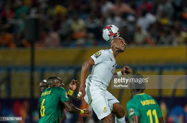 Andre Morgan Rami Ayew of Ghana and Ambroise Oyongo Bitolo of Cameroon during the 2019 African Cup of Nations match between Benin and Guinea-Bissau...