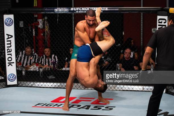 Andre Muniz of Brazil attempts to submit Bruno Assis of Brazil in their middleweight bout during Dana White's Contender Series Brazil at the TUF Gym...