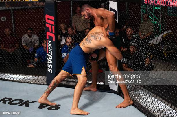 Andre Muniz of Brazil controls the body of Bruno Assis of Brazil in their middleweight bout during Dana White's Contender Series Brazil at the TUF...