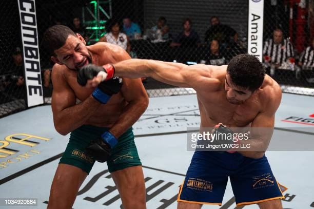 Andre Muniz of Brazil punches Bruno Assis of Brazil in their middleweight bout during Dana White's Contender Series Brazil at the TUF Gym on August...