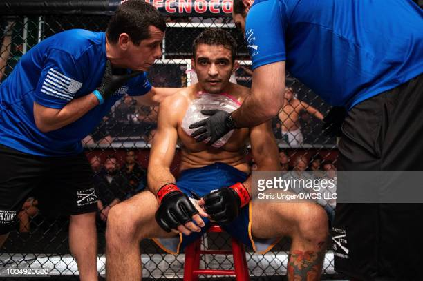 Andre Muniz of Brazil rests in his corner between rounds of his middleweight bout with Bruno Assis of Brazil during Dana White's Contender Series...