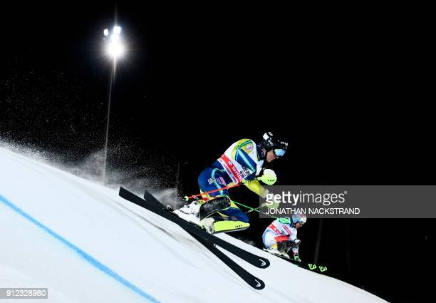 Andre Myhrer of Sweden and Luca Aerni of Switzerland compete during the FIS Ski World Cup parallel slalom city event in Stockholm Sweden on January...