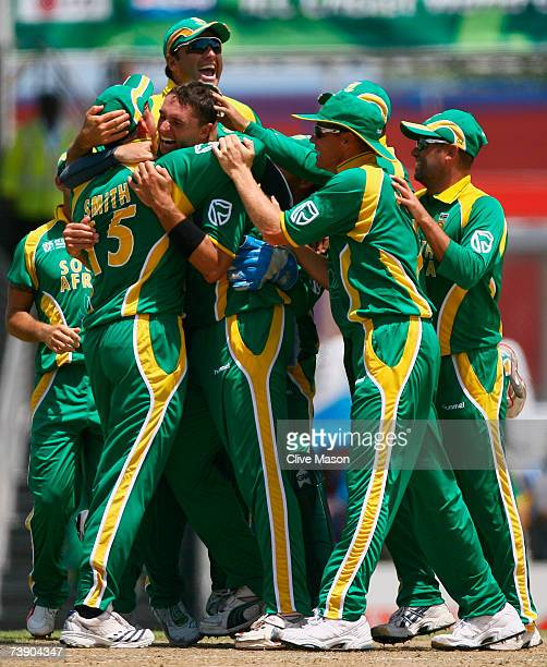Andre Nel of South Africa celebrates the wicket of Kevin Pietersen of England during the ICC Cricket World Cup Super Eights match between South...