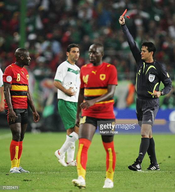 Andre of Angola is shown the red card by referee Shamsul Maidin during the FIFA World Cup Germany 2006 Group D match between Mexico and Angola played...