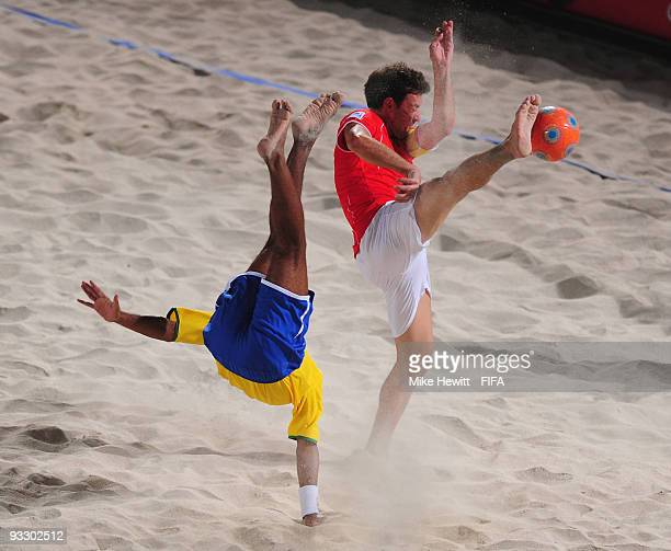 Andre of Brazil scores the first goal of the game as Mo Jaeggy of Switzerland fails to block during the FIFA Beach Soccer World Cup Final between...