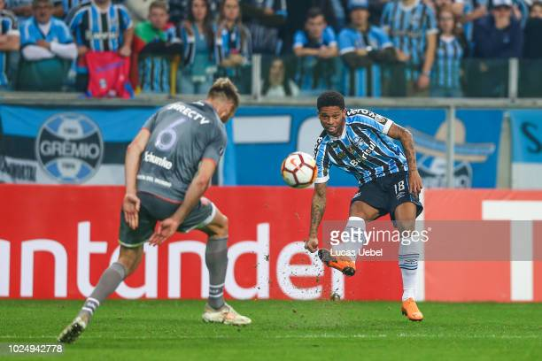 Andre of Gremio battles for the ball against Jonathan Schunke of Estudiantes during the match between Gremio and Estudiantes part of Copa Conmebol...