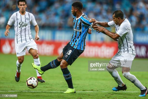 Andre of Gremio battles for the ball against Paulo da Silva of Libertad during the match between Gremio and Libertad part of Copa Conmebol...