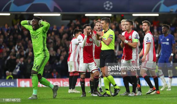 Andre Onana and Dusan Tadic of AFC Ajax react after 2 red cards are given during the UEFA Champions League group H match between Chelsea FC and AFC...