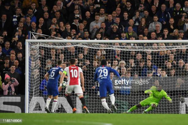 Andre Onana of AFC Ajax dives the wrong way as Jorginho of Chelsea scores his team's third goal during the UEFA Champions League group H match...