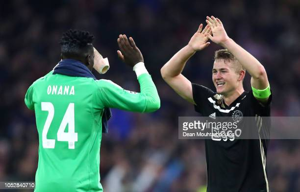 Andre Onana of Ajax and Matthijs de Ligt of Ajax celebrate following their sides victory in the Group E match of the UEFA Champions League between...