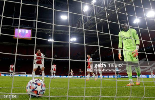 Andre Onana of Ajax and teammates look dejected after Nicolas Tagliafico of Ajax scores an own goal for Liverpool's first during the UEFA Champions...