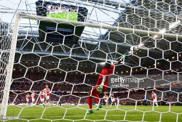 Andre Onana of Ajax attempts to save as Paul Pogba of Manchester United scores his sides first goal during the UEFA Europa League Final between Ajax...