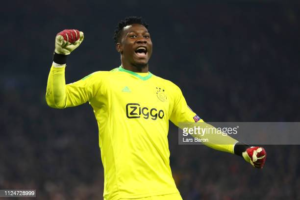 Andre Onana of Ajax celebrates after scoring his team's first goal during the UEFA Champions League Round of 16 First Leg match between Ajax and Real...