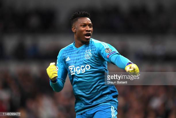 Andre Onana of Ajax celebrates as Donny van de Beek scores his team's first goal during the UEFA Champions League Semi Final first leg match between...
