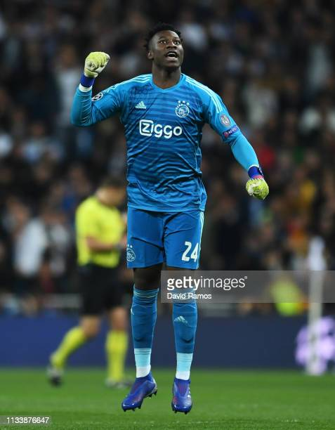 Andre Onana of Ajax celebrates as Hakim Ziyech scores his team's first goal during the UEFA Champions League Round of 16 Second Leg match between...