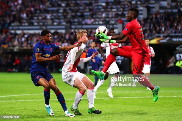 Andre Onana of Ajax collects the ball under pressure from Marcus Rashford of Manchester United during the UEFA Europa League Final match between Ajax...