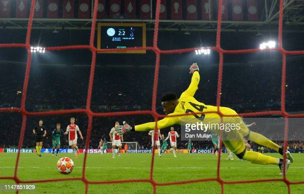 Andre Onana of Ajax dives as Lucas Moura of Tottenham Hotspur scores his team's third goal during the UEFA Champions League Semi Final second leg...