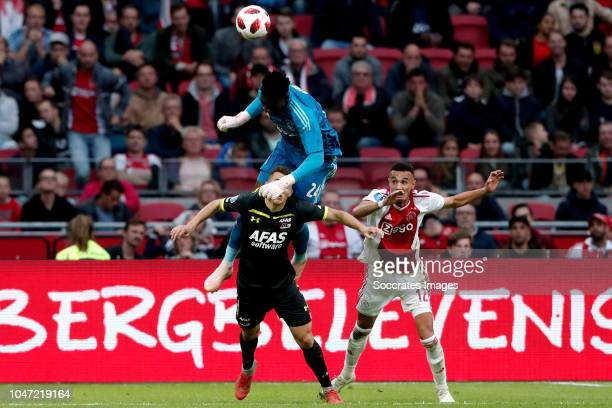 Andre Onana of Ajax Oussama Idrissi of AZ Alkmaar Noussair Mazraoui of Ajax during the Dutch Eredivisie match between Ajax v AZ Alkmaar at the Johan...