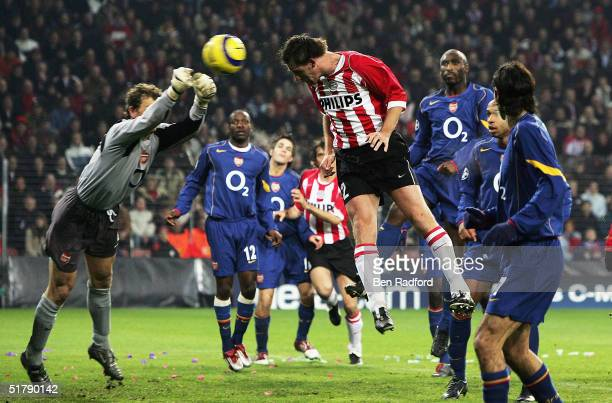 Andre Ooijer of PSV Eindhoven scores as Jens Lehman of Arsenal fails to clear during the Group E UEFA Champion's League match between PSV Eindhoven...