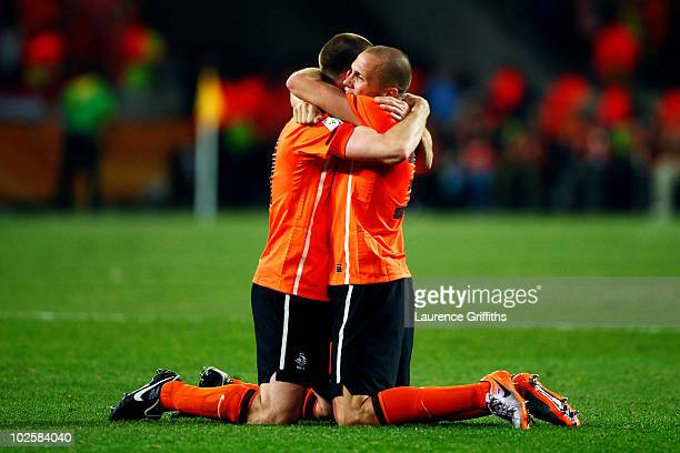 Andre Ooijer of the Netherlands celebrates with team mate John Heitinga after victory and progress to the semifinals during the 2010 FIFA World Cup...