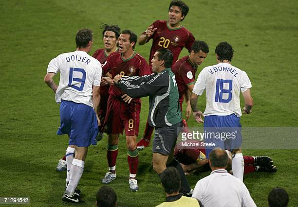Andre Ooijer of the Netherlands scuffles with Portuguese players, after Khalid Boulahrouz of the Netherlands, is shown the red card by Referee...