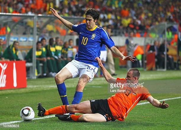 Andre Ooijer of the Netherlands tackles Kaka of Brazil during the 2010 FIFA World Cup South Africa Quarter Final match between Netherlands and Brazil...