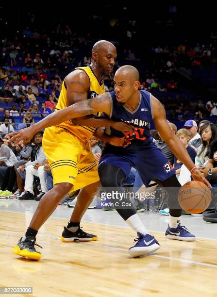 Andre Owens of 3's Company drives past Chauncey Billups of the Killer 3s during week seven of the BIG3 three on three basketball league at Rupp Arena...