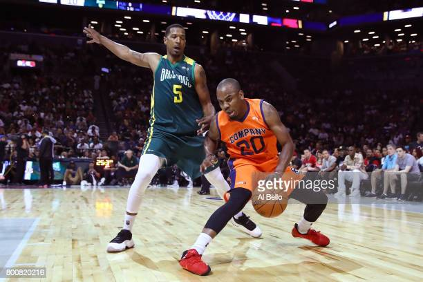 Andre Owens of 3's Company handles the ball against Dominic McGuire of the Ball Hogs during week one of the BIG3 three on three basketball league at...