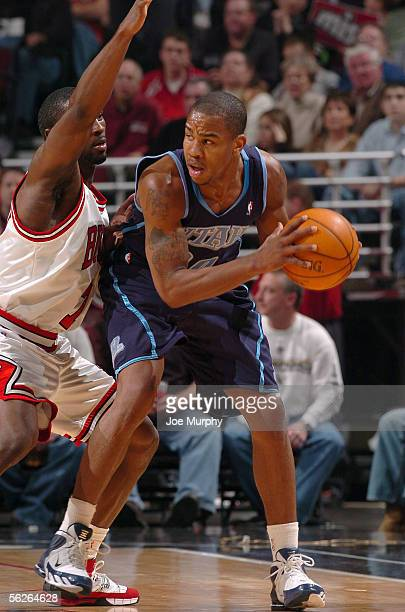 Andre Owens of the Utah Jazz looks for an open pass around Ben Gordon of the Chicago Bulls during the game at the United Center on November 12, 2005...