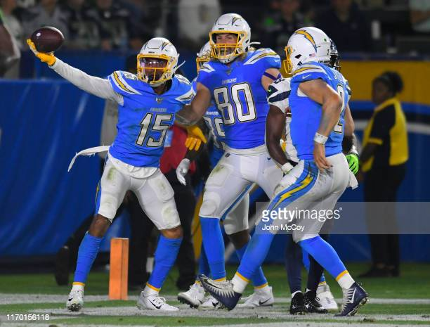 Andre Patton of the Los Angeles Chargers celebrates his touchdown with Sean Culkin and Eston Stick while playing the Seattle Seahawks during a...