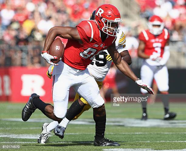 Andre Patton of the Rutgers Scarlet Knights carries the ball as Miles Taylor of the Iowa Hawkeyes defends at High Point Solutions Stadium on...