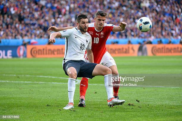 Andre Pierre Gignac and Granit Xhaka of France during the UEFA EURO 2016 Group A match between Switzerland and France at Stade PierreMauroy on June...