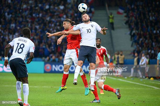 Andre Pierre Gignac of France and Ricardo Rodriguez of Switzerland during the UEFA EURO 2016 Group A match between Switzerland and France at Stade...
