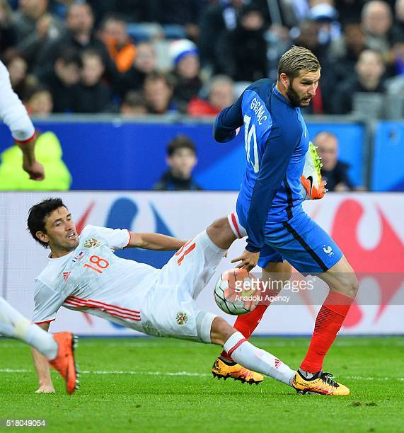 Andre Pierre Gignac of France in action against Yury Zhirkov of Russia during the friendly football match between France and Russia at Stade de...