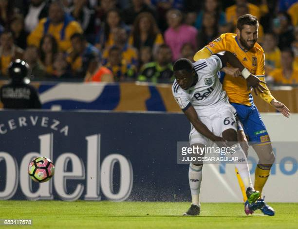 Andre Pierre Gignac of Mexico's Tigres vies for the ball with Alphonso Davies of Canadas Vancouver Whitecaps during their CONCACAF Champions League...