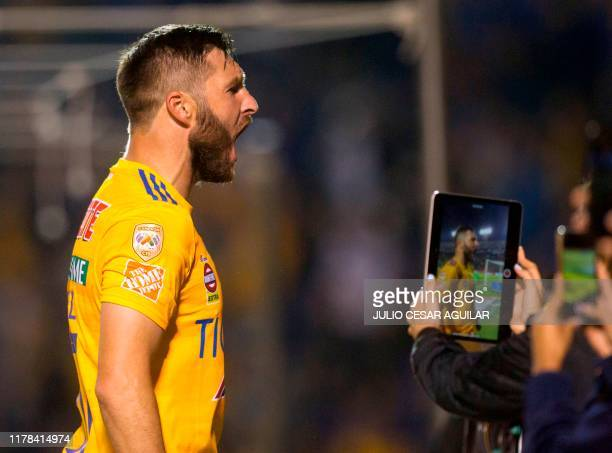 Andre Pierre Gignac of Tigres celebrates after scoring during the Mexican Apertura 2019 tournament football match at the Universitarian stadium in...