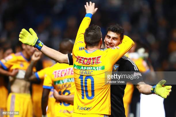 Andre Pierre Gignac of Tigres celebrates with teammate Nahuel Guzman after winning the second leg of the Torneo Apertura 2017 Liga MX final between...