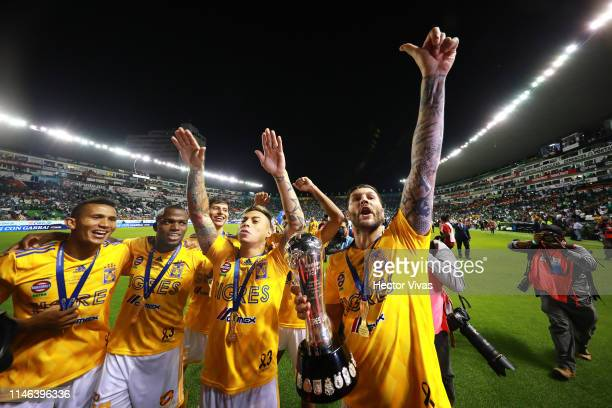 Andre Pierre Gignac of Tigres holds the Championship Trophy with teammates after the final second leg match between Leon and Tigres UANL as part of...