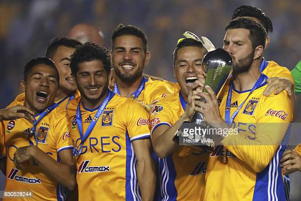Andre Pierre Gignac of Tigres kisses the champion trophy after the Final second leg match between Tigres UANL and America as part of the Torneo...