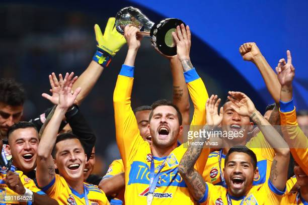 Andre Pierre Gignac of Tigres lifts the trophy to celebrate after winning the second leg of the Torneo Apertura 2017 Liga MX final between Monterrey...
