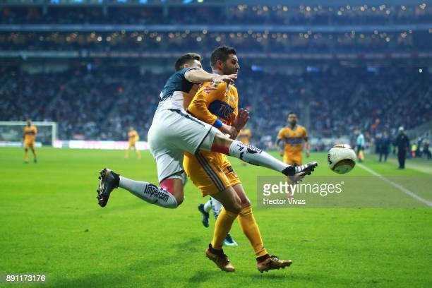Andre Pierre Gignac of Tigres struggles for the ball with Cesar Montes of Monterrey during the second leg of the Torneo Apertura 2017 Liga MX final...