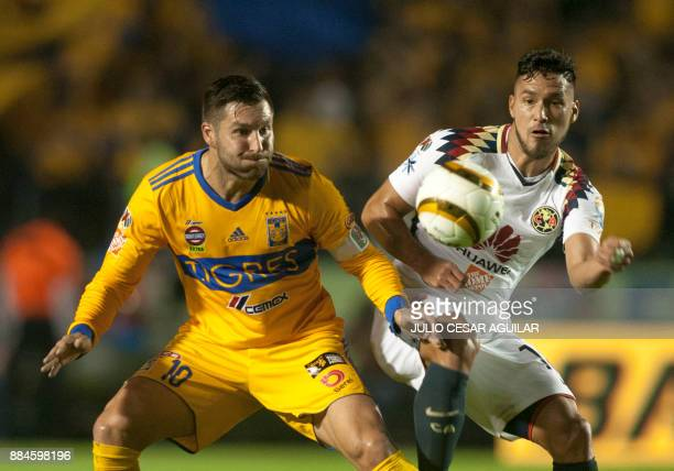 Andre Pierre Gignac of Tigres vies for the ball with Bruno Valdez of America during their semifinal Mexican Apertura 2017 tournament football match...