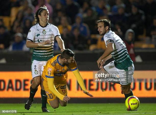 Andre Pierre Gignac of Tigres vies for the ball with Carlos Izquierdoz and Jose Abella of Santos during their Mexican Clausura 2018 tournament...