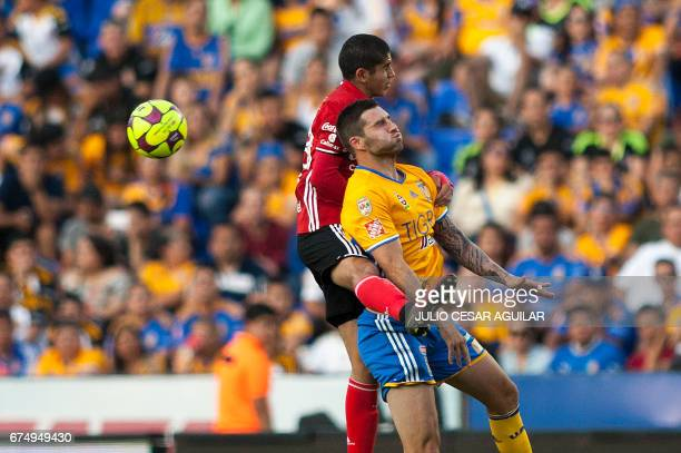 Andre Pierre Gignac of Tigres vies for the ball with Carlos Vargas of Tijuana during the Mexican Clausura 2017 tournament football match at the...