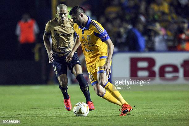 Andre Pierre Gignac of Tigres vies for the ball with Dario Veron of Pumas during their Mexican Apertura tournament football match first leg of the...