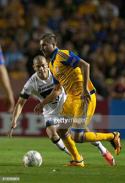 Andre Pierre Gignac of Tigres vies for the ball with Dario Veron of Pumas during the Mexican Clausura 2016 tournament football match at the...