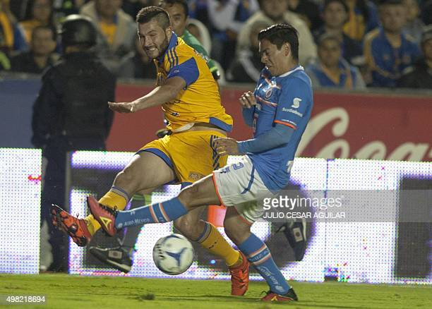 Andre Pierre Gignac of Tigres vies for the ball with Fausto Pintp of Cruz Azul during the Mexican Apertura 2015 tournament football match at the...