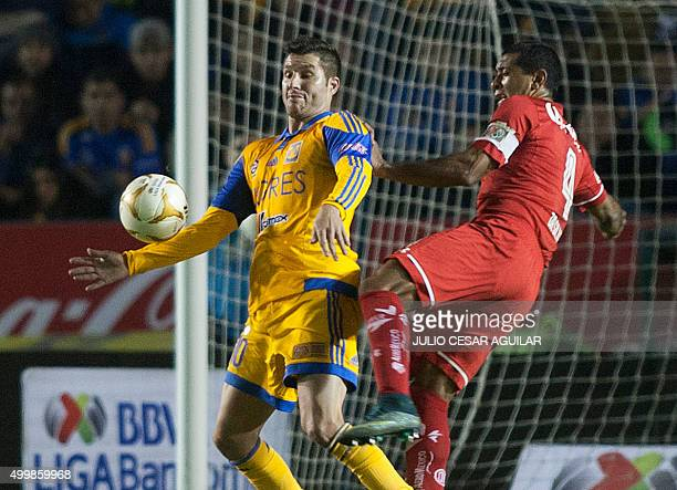 Andre Pierre Gignac of Tigres vies for the ball with Paulo Da Silva of Toluca during the first leg of the semifinal of the Mexican Apertura 2015...