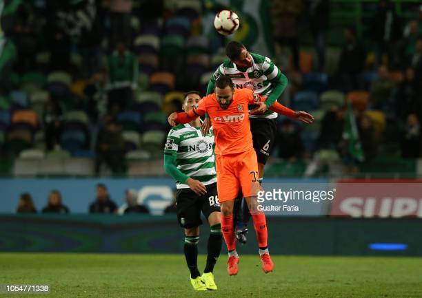 Andre Pinto of Sporting CP with Rafael Lopes of Boavista FC in action during the Liga NOS match between Sporting CP and Boavista FC at Estadio Jose...