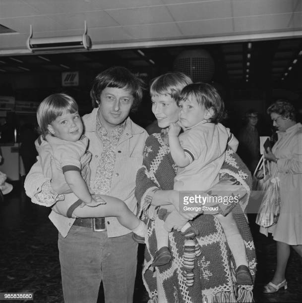 Andre Previn and actress Mia Farrow pictured with their twins Matthew and Sascha at Heathrow airport in London on 21st August 1972